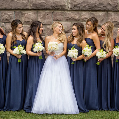 bridesmaids laughing group photo at newhall mansion