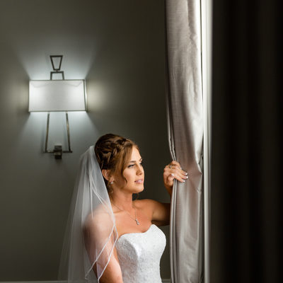 beautiful bride looking out window