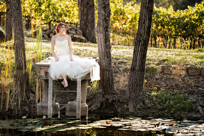 bride sitting on villa aix vineyards pond deck