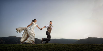groom running with bride