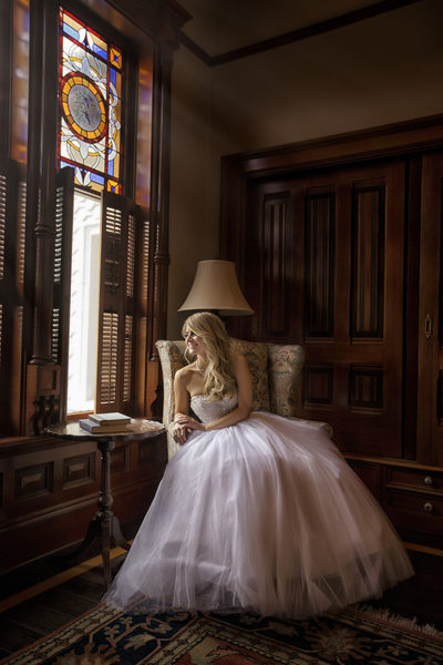 bride looking out window at newhall mansion