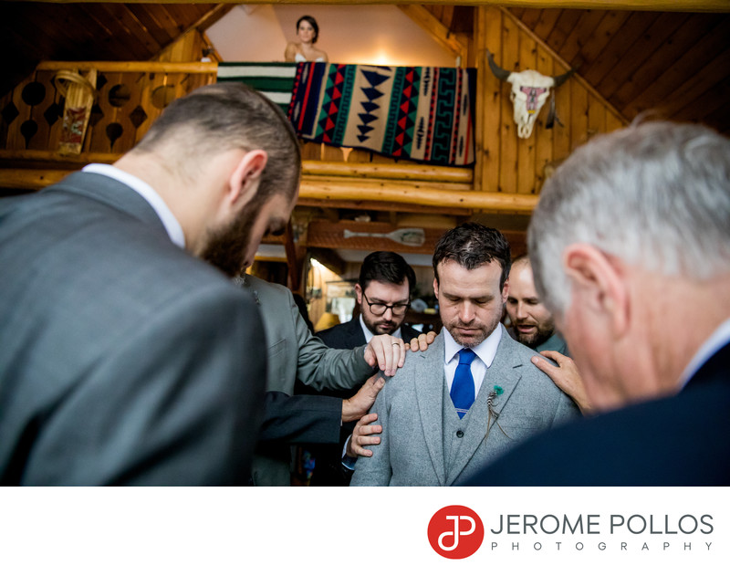 Groom Prayer While Bride Watches Elk Mountain Resort