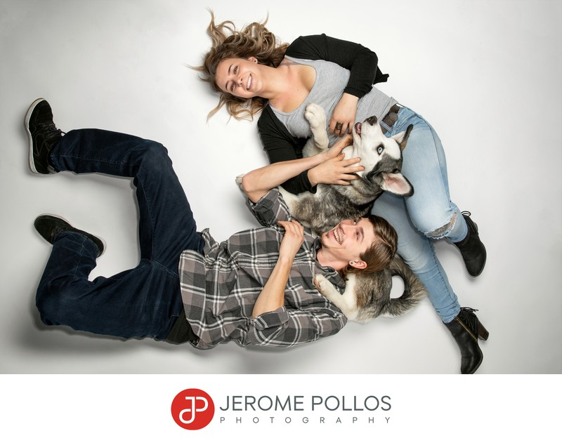 Couple and dog having fun in studio portrait session
