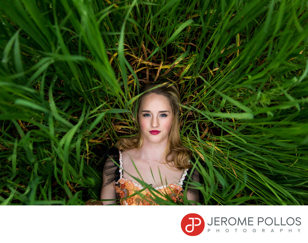 Laying In Tall Grass Senior Portrait
