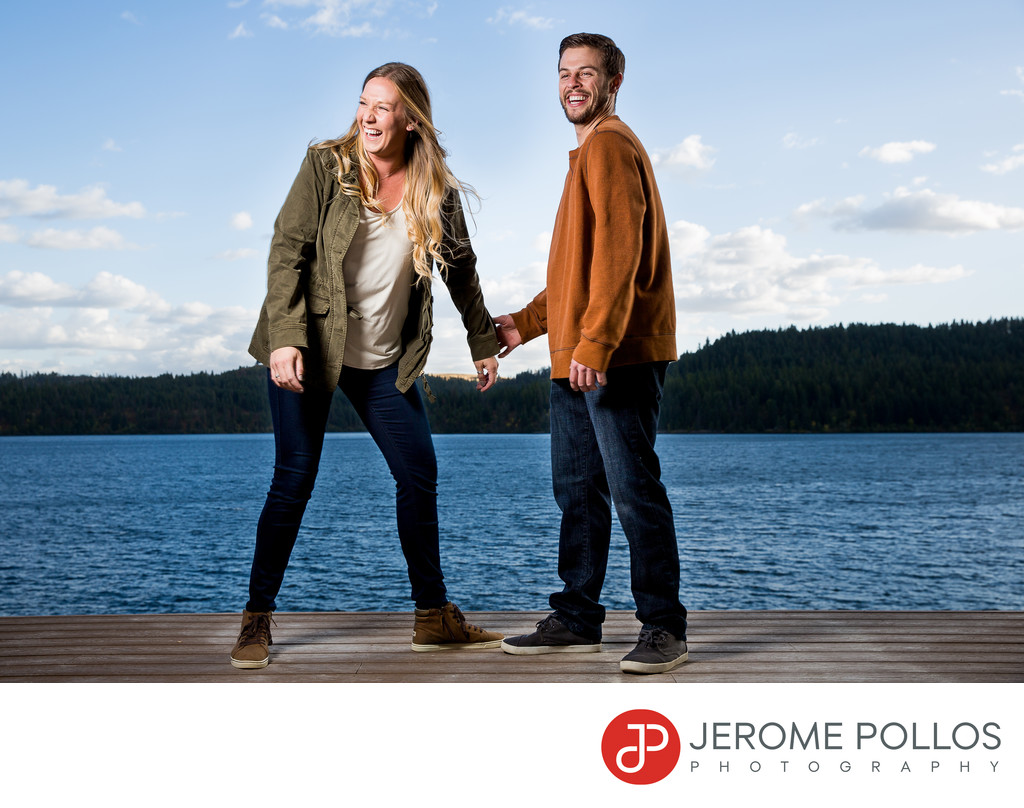 Laughing By The Lake Engagement Portrait