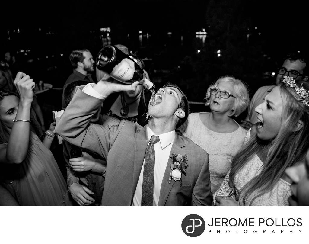 Groom Chugs Champagne Post Falls Wedding Reception