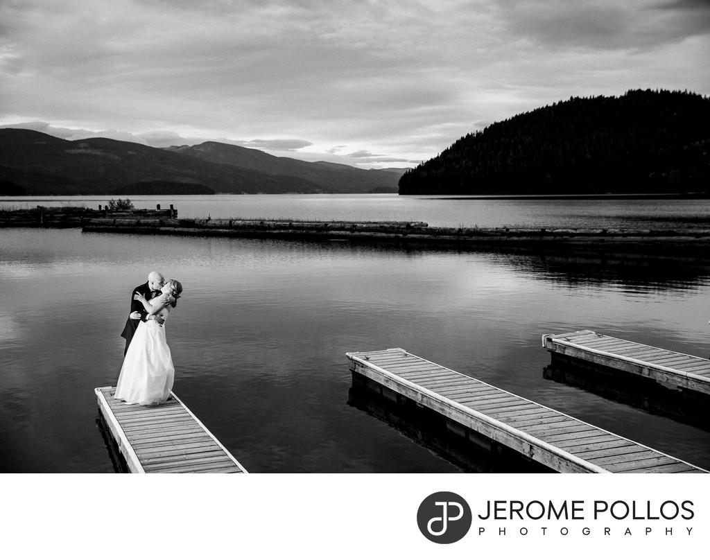 Bride And Groom Kiss On Elkins Resort On Priest Lake