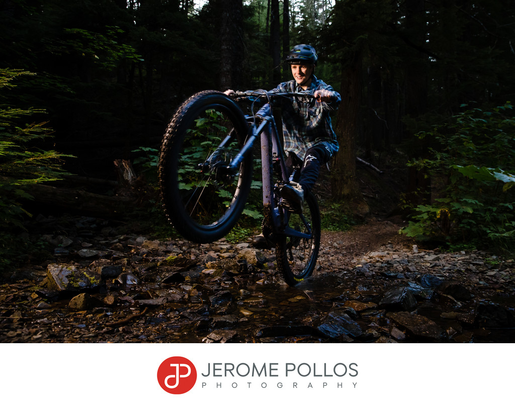 Mountain biking senior portrait wheelie Coeur d'Alene