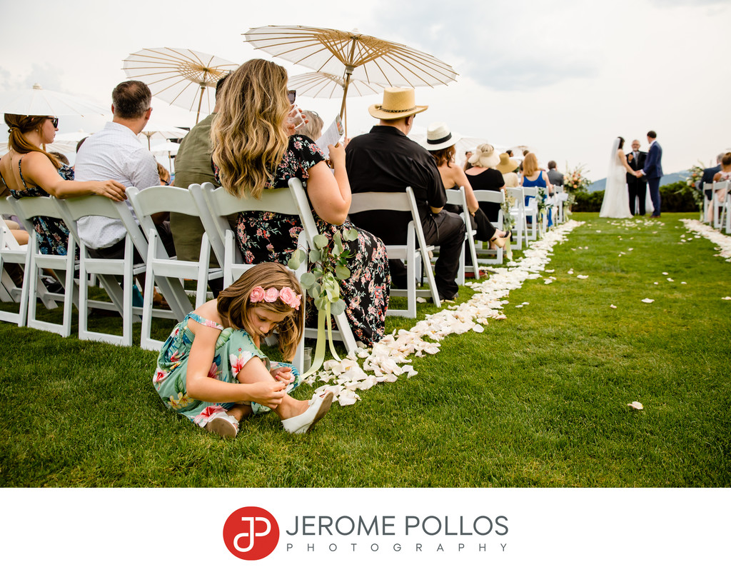 Young wedding guest entertains herself during ceremony
