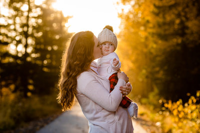 Sunset Mom Baby Kiss Lifestyle Family Portrait