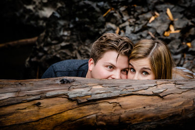 Playful Engagement Picture Behind Log