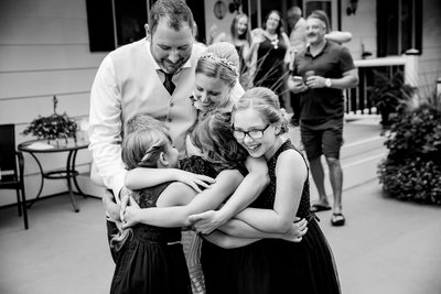 Blended Family Wedding Reception Group Hug