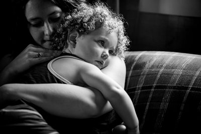 Mother comforts daughter family lifestyle portrait