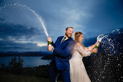 Bride and groom poppin' bottles at Elk Point wedding