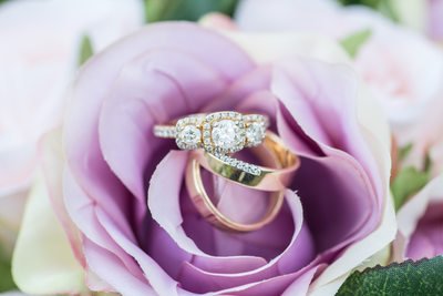 Purple bouquet wedding rings