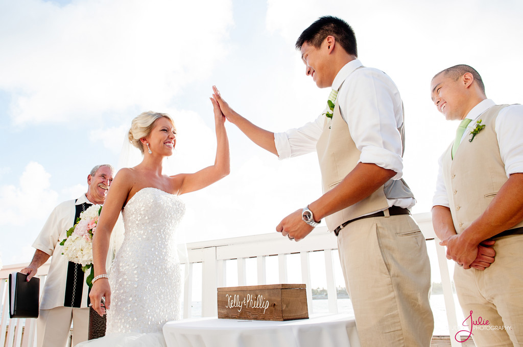 Bride and Groom high five at Ocean Key resort