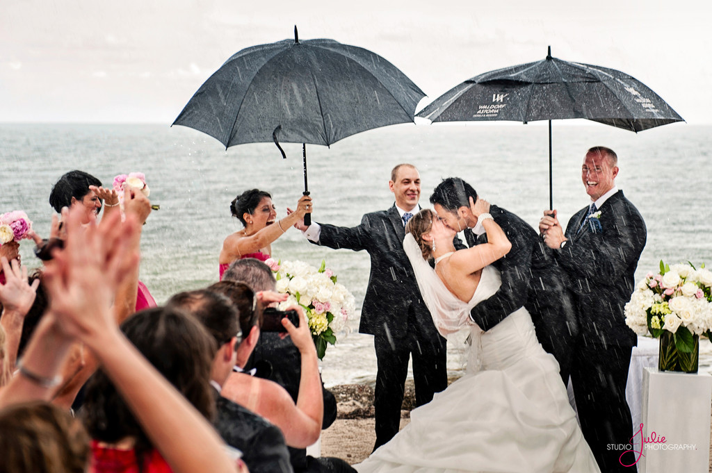 Kiss in the rain  at the Casa Marina Resort