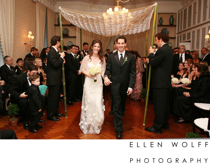 bride and groom under the chuppah at Pratt