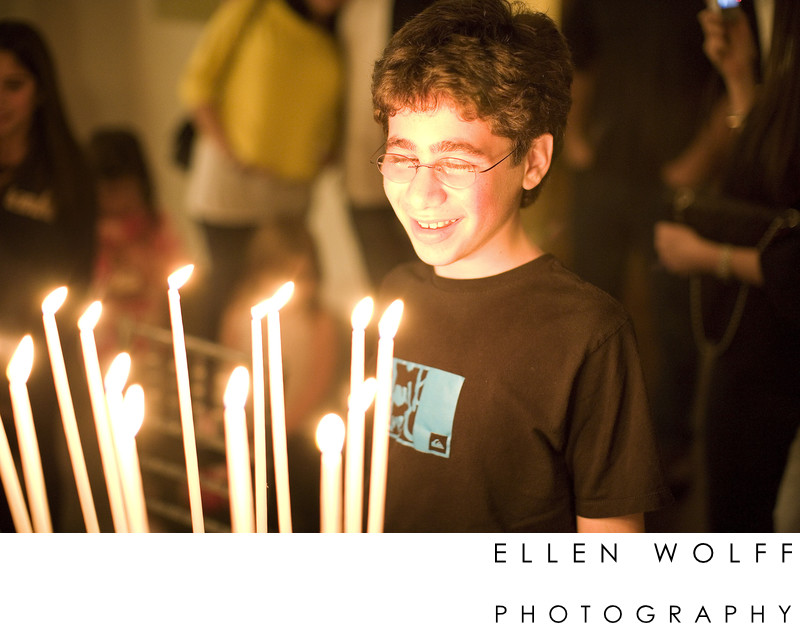 bar mitzvah portrait with candle light from the cake