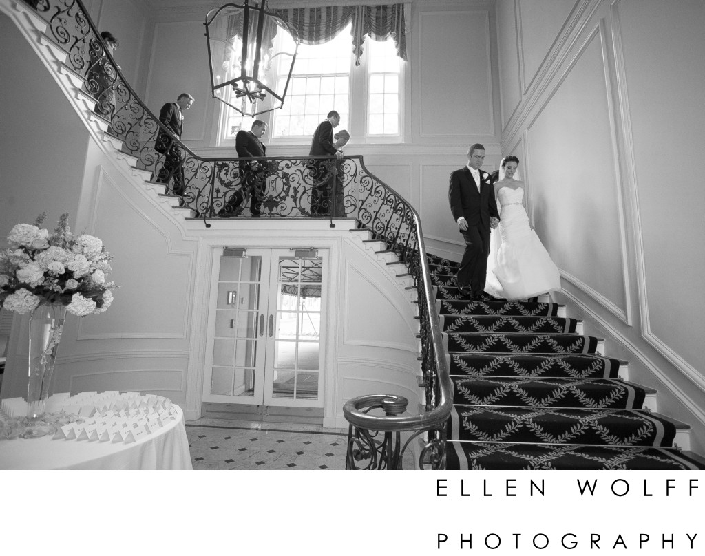 bride and groom descending the stairs at muttontown  cc