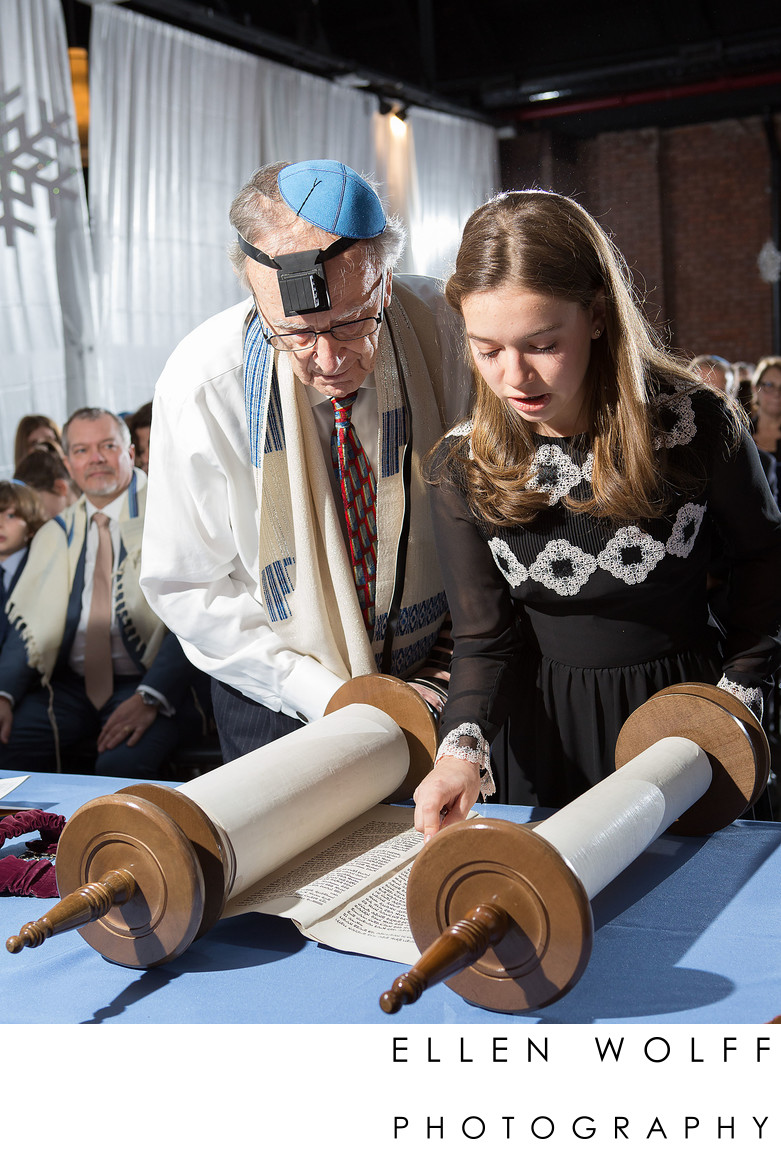 bat mitzvah and grandfather read together from the torah