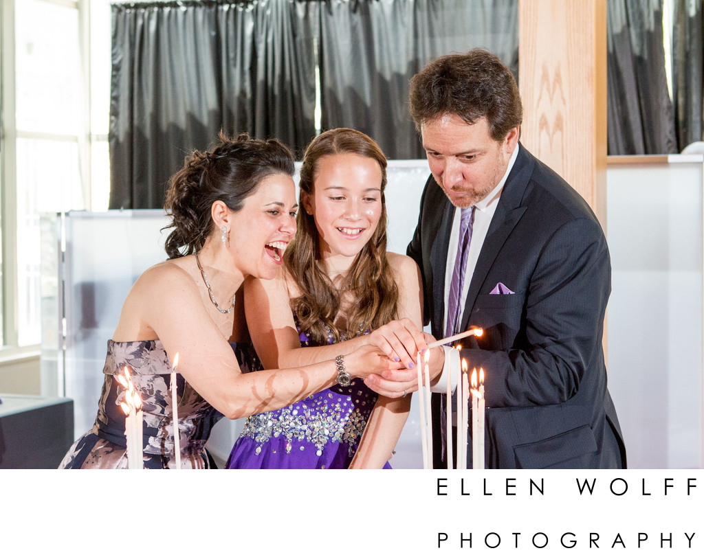 excited parents light bat mitzvah candle