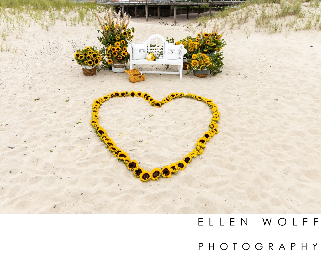 sunflower floral decor for a beach marriage proposal