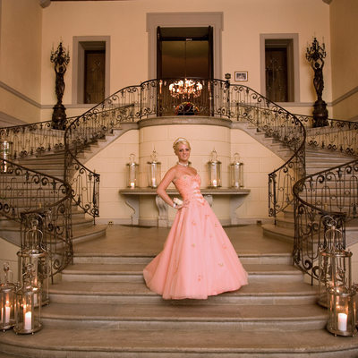 sweet 16 portrait on the main staircase at oheka castle