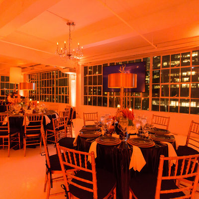 studio 450 bathed in orange for a Surprise 60th Birthday Party