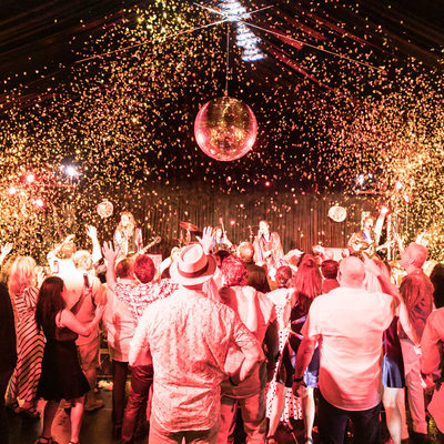 gold confetti showers guests