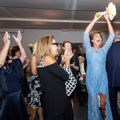 The excitement of catching the bouquet. A620 Loft Garden wedding.