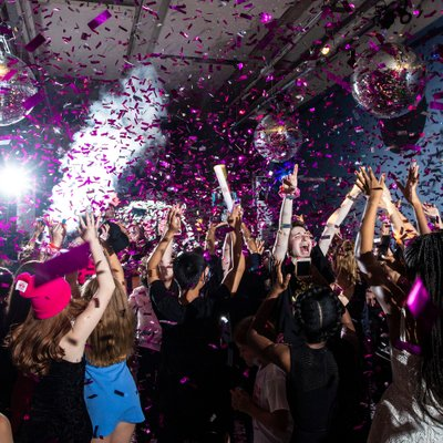 purple confetti sprayed on the dance floor