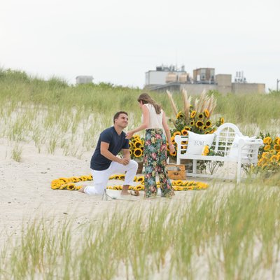 surprise proposal at the beach