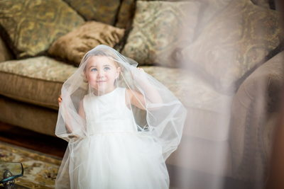 Flower girl imitating the bride