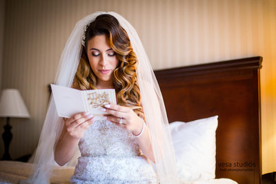 Bride reading a note from her future husband