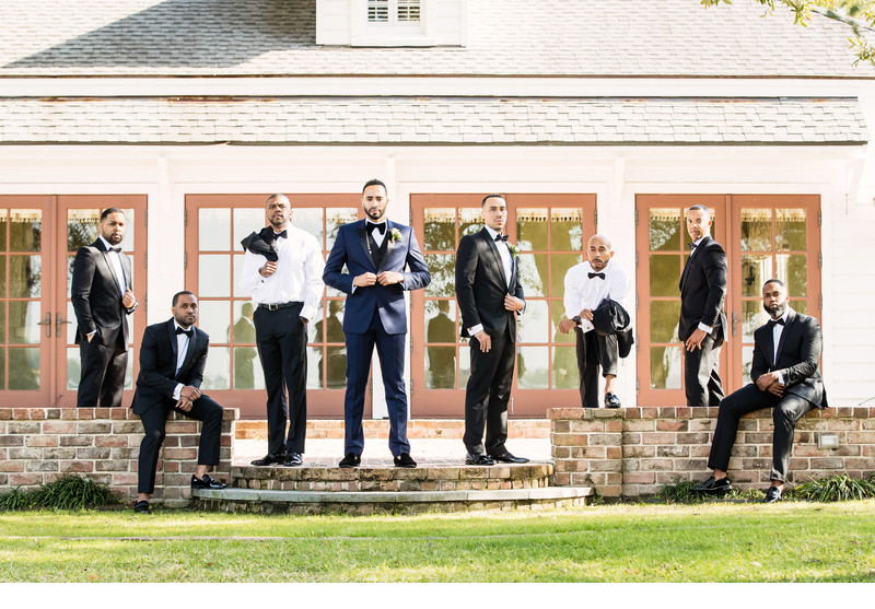 Stylish photo of groom at lowndes grove plantation
