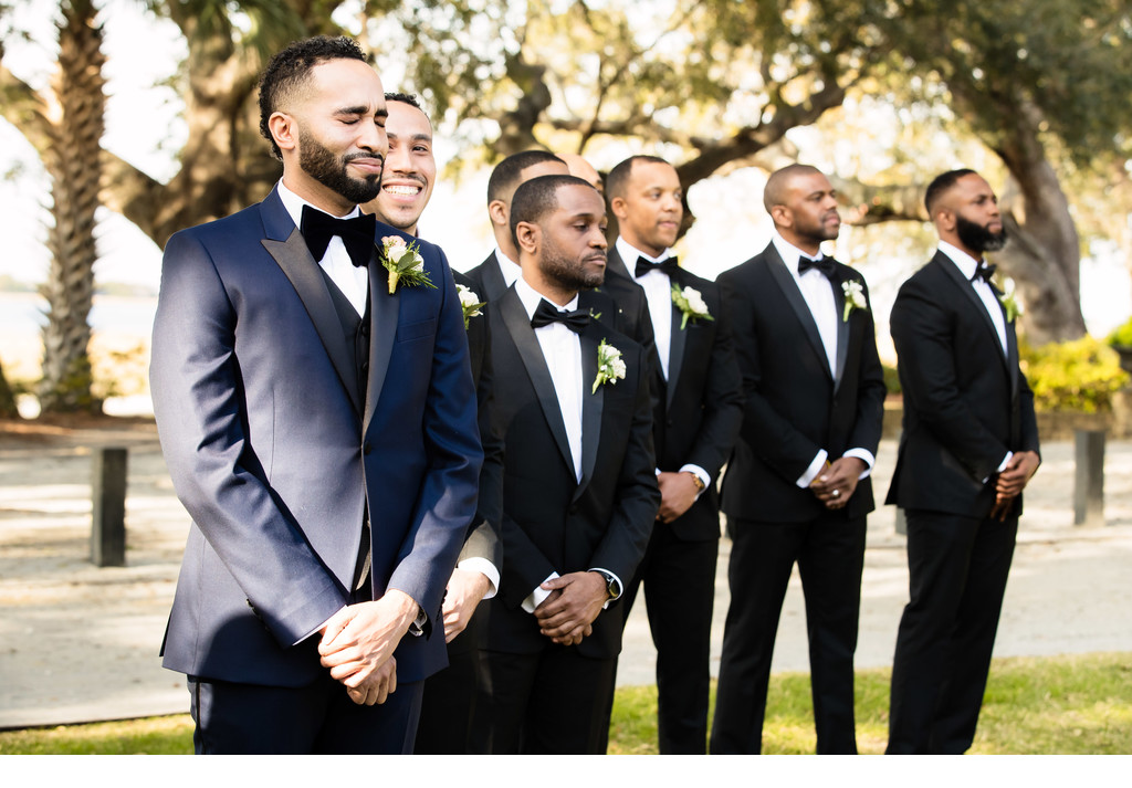Groom crying at Lowndes Grove Plantation wedding