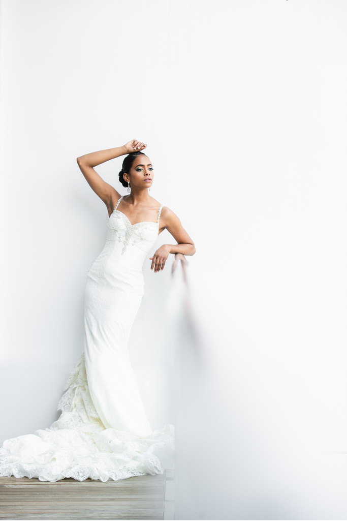 Bride posing elegantly in Winnie Couture gown