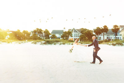 bride and groom on the beach at Sonesta Hilton Head