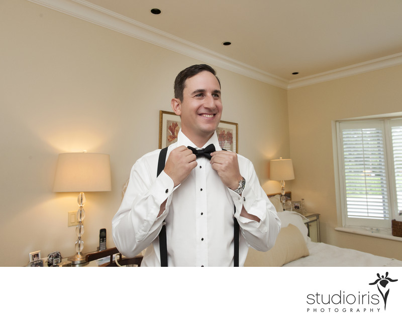 Photos of groom with a bow tie