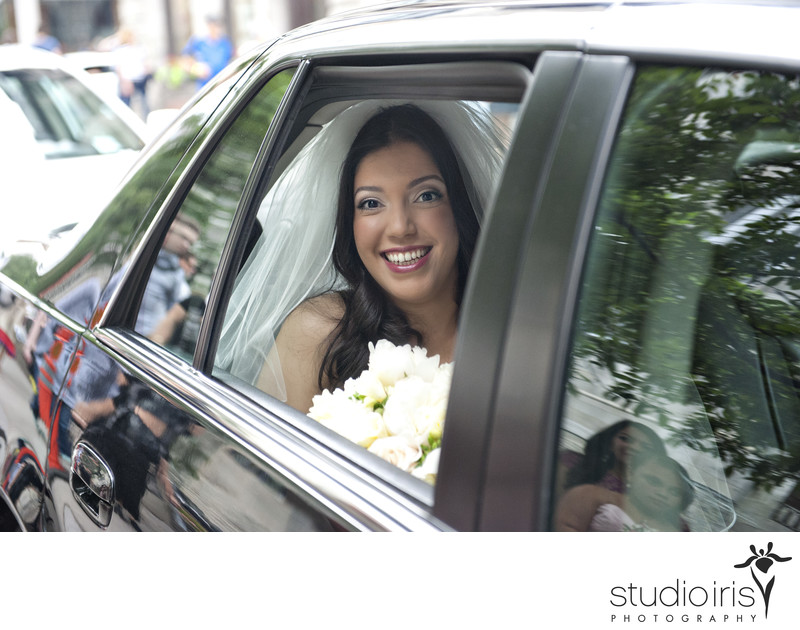 bride in limo on the way to her wedding in montreal