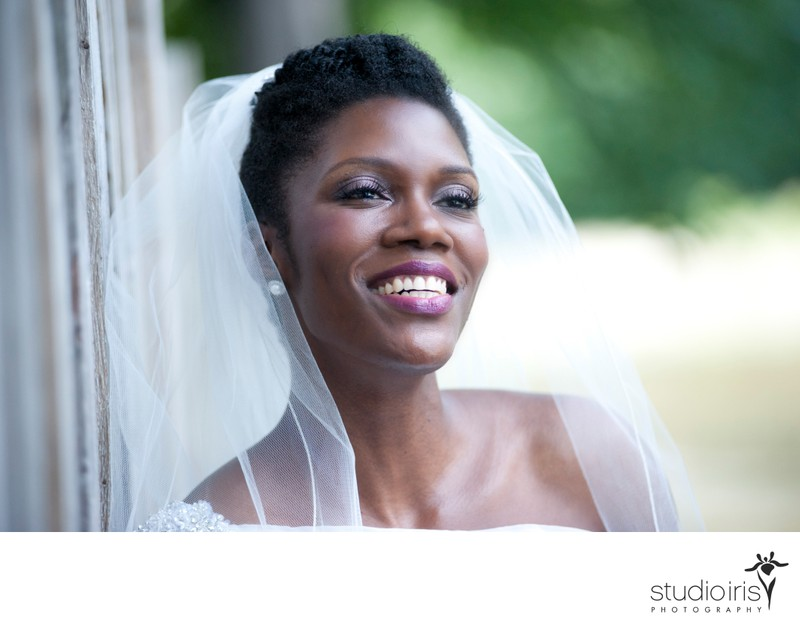 Radiant bride looking into the distance and smiling