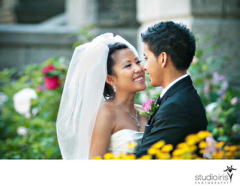 Bride and groom surrounded by flowers during their Vietnamese wedding in montreal
