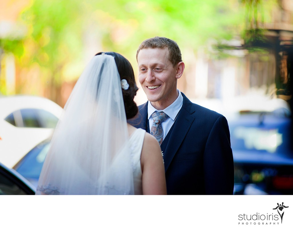 Groom gazing at bride on the street in Montreal before Jewish wedding at Bagg Street Synagogue