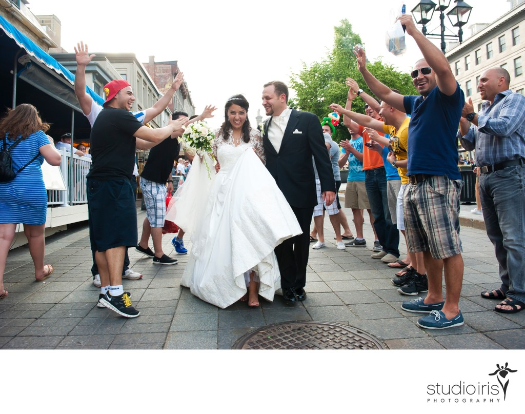 Newlyweds walk through impromptu congratulations from crowd in Old Montreal