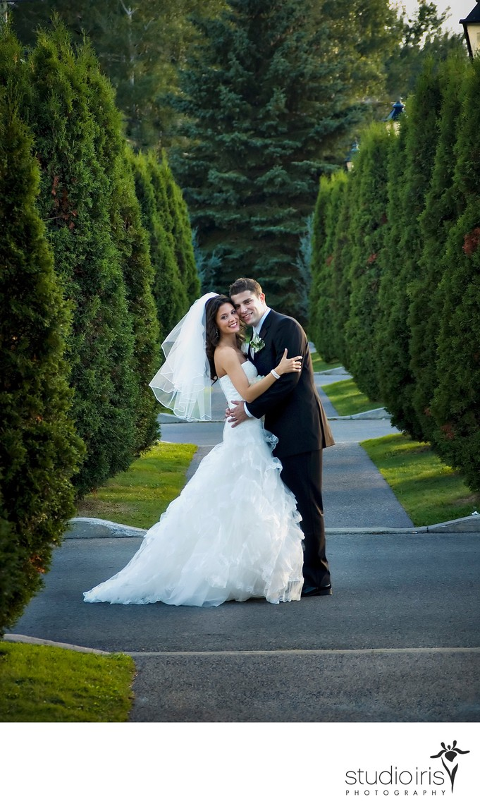 Newlyweds embracing after their outdoor wedding at Golf Saint Raphael