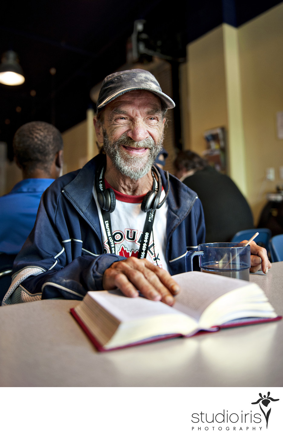 Ramond Carrier enjoys a free cup of coffee and place to read his book at Montreal's Café Mission