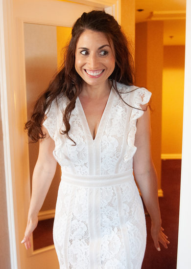 Excited bride before wedding in Montreal hotel room