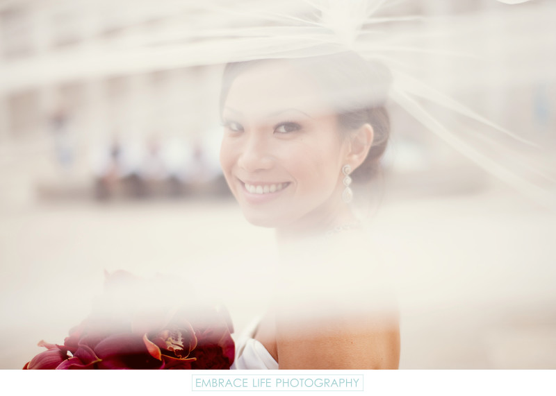 Wedding Portrait of Bride Looking Through Her Veil