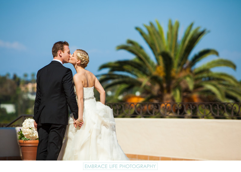 Wedding Couple Kiss with Pacific Palisades Background